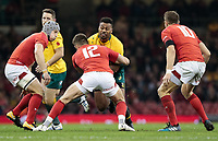 Australia's Tevita Kuridrani under pressure from Wales' Owen Williams<br /> <br /> Photographer Simon King/CameraSport<br /> <br /> International Rugby Union - 2017 Under Armour Series Autumn Internationals - Wales v Australia - Saturday 11th November 2017 - Principality Stadium - Cardiff<br /> <br /> World Copyright &copy; 2017 CameraSport. All rights reserved. 43 Linden Ave. Countesthorpe. Leicester. England. LE8 5PG - Tel: +44 (0) 116 277 4147 - admin@camerasport.com - www.camerasport.com