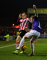 Lincoln City's Danny Rowe vies for possession with Exeter City's Matt Jay<br /> <br /> Photographer Chris Vaughan/CameraSport<br /> <br /> The EFL Sky Bet League Two - Lincoln City v Exeter City - Tuesday 26th February 2019 - Sincil Bank - Lincoln<br /> <br /> World Copyright © 2019 CameraSport. All rights reserved. 43 Linden Ave. Countesthorpe. Leicester. England. LE8 5PG - Tel: +44 (0) 116 277 4147 - admin@camerasport.com - www.camerasport.com