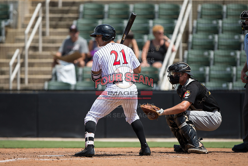 Seby Zavala (21) of the Kannapolis Intimidators at bat against the West Virginia Power at Kannapolis Intimidators Stadium on June 18, 2017 in Kannapolis, North Carolina.  The Intimidators defeated the Power 5-3 to win the South Atlantic League Northern Division first half title.  It is the first trip to the playoffs for the Intimidators since 2009.  (Brian Westerholt/Four Seam Images)