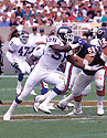 New York Giants Lawrence Taylor (56) in action during a game against the Chicago Bears on September 5, 1993 at Soldier Field in Chicago, Illinois. The Giants beat the Bears 26-20. Lawrence Taylor was inducted to the Pro Football Hall of Fame in 1999.