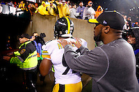 Head coach Mike Tomlin and James Harrison #92 of the Pittsburgh Steelers walk off of the field together following their 18-16 win against the Cincinnati Bengals during the Wild Card playoff game at Paul Brown Stadium on January 9, 2016 in Cincinnati, Ohio. (Photo by Jared Wickerham/DKPittsburghSports)