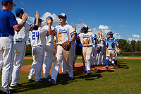 South Dakota State Jackrabbits Matthew Krambeck (23), Josh Kutzke (25), and Derek Hackman (9) celebrate with teammates after a game against the FIU Panthers on February 23, 2019 at North Charlotte Regional Park in Port Charlotte, Florida.  South Dakota State defeated FIU 4-3.  (Mike Janes/Four Seam Images)
