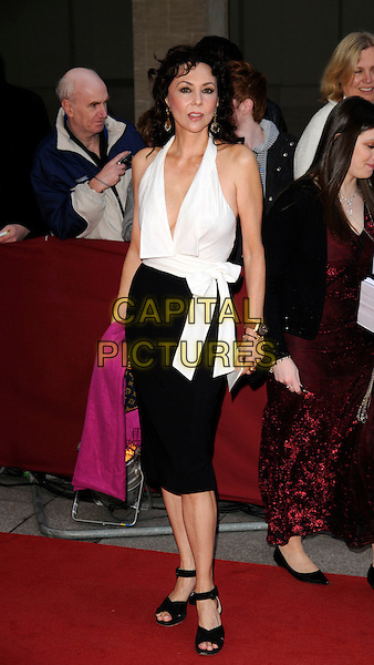 MARIE HELVIN.The Galaxy British Book Awards held at the Grosvenor Hotel, Park Lane, London, England. .April 9th, 2008 .full length white halterneck top black skirt pink pashmina .CAP/CAN.©Can Nguyen/Capital Pictures.