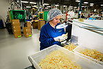 WATERBURY,  CT-051619JS02-  Miriam Rodriguez, and employee at Forum Plastics, does quality control on products Thursday at their plant in Waterbury. Company executives have said they will be forced to eliminate jobs or relocate if the state enacts the $15 minimum wage. <br /> Jim Shannon Republican American