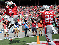 Ohio State Buckeyes wide receiver Parris Campbell (21) celebrates with teammate Ohio State Buckeyes wide receiver Johnnie Dixon (1) after scoring a touchdown during the third quarter of a NCAA college football game between the Ohio State Buckeyes and the Oregon State Beavers on Saturday, September 1, 2018 at Ohio Stadium in Columbus, Ohio. [Joshua A. Bickel/Dispatch]