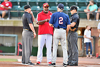 Umpire Zachary Robbins, Greenville Reds manager Gookie Dawkins (9), Elizabethton Twins manager Ray Smith (2) and home plate umpire Kaleb Devier before a game between the Elizabethton Twins and the Greenville Reds at Pioneer Park on June 29, 2019 in Greeneville, Tennessee. The Twins defeated the Reds 8-1. (Tony Farlow/Four Seam Images)