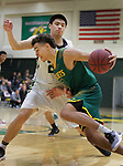 SPEARFISH, SD: NOVEMBER 11:  Patrick Mendes #0 of Black Hills State drives past Harry Sun #23 of Yellowstone Christian during their game Saturday at the Donald E. Young Center in Spearfish, S.D.   (Photo by Dick Carlson/Inertia)