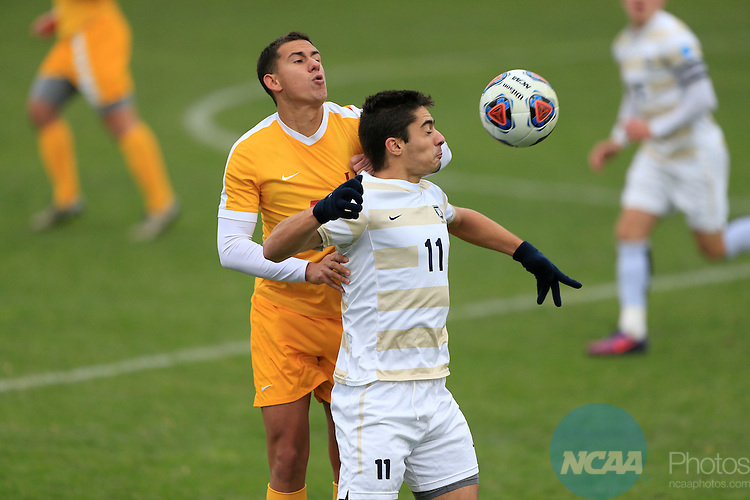 KANSAS CITY, MO - DECEMBER 03:  Jon Ander (11) of Wingate University and Danilo Dias (55) of the University of Charleston battle for the ball during the Division II Men's Soccer Championship held at Children's Mercy Victory Field at Swope Soccer Village on December 03, 2016 in Kansas City, Missouri. Wingate beat Charleston 2-0 to win the National Championship. (Photo by Jack Dempsey/NCAA Photos via Getty Images)