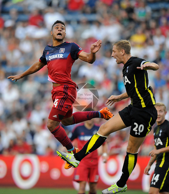 Football - International Friendly - Tottenham Hotspurs at Chicago Fire.      <br /> Chicago Fire forward Quincy Amarikwa (24, left) and Tottenham defender Michael Dawson (20) both leap for a header in the first half. The Tottenham Hotspurs played the Chicago Fire in an international friendly game at Toyota Park in Bridgeview, Illlinois on Saturday July 26, 2014.