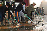 Ishinomaki, Japan - U.S. service members, members of the Japan Self-Defense Force and students of Ishinomaki High School work  together to clean the school during Operation Field Day in Ishinomaki, March 30. U.S. service members are working with their Japanese counterparts to provide assistance in support of Operation Tomodachi. (Photo by USMC/AFLO) [0006]