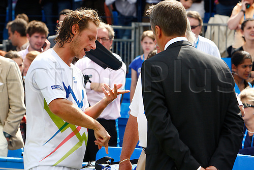 17.06.12 Queens Club, London, ENGLAND: David Nalbandian ARG having words with Referee Tom Barnes mens singles final round match during Marin Cilic CRO versus David Nalbandian ARG on day Seven of the Aegon Championships at Queens Club .on June 17, 2012 in London , England. Nalbandian was disqualified from the Championships final after injuring the line judge by kicking an advertising board onto his shin.