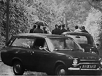 Uniformed and plain-clothed police officers and a forensic team at the scene following the discovery of a body on a quiet Co Down, N Ireland road. The body was that of a high-ranking UDA officer, Tommy Herron, who had been missing for several days. 16th September 1973. 197309160001TH<br /> <br /> Copyright Image from Victor Patterson, 54 Dorchester Park, Belfast, UK, BT9 6RJ<br /> <br /> t1: +44 28 9066 1296 (from Rep of Ireland 048 9066 1296)<br /> t2: +44 28 9002 2446 (from Rep of Ireland 048 9002 2446)<br /> m: +44 7802 353836<br /> <br /> victorpattersonbelfast@gmail.com<br /> victorpatterson@me.com<br /> <br /> www.victorpatterson.com<br /> <br /> Please see my Terms and Conditions of Use at https://www.victorpatterson.com/page2<br /> It is IMPORTANT that you familiarise yourself with them.<br /> <br /> Images used on the Internet incur an additional cost and must be visibly watermarked i.e. © Victor Patterson within the body of the image and copyright metadata must not be deleted. Images used on the Internet have a size restriction of 4kbs and are chargeable at rates available at victorpatterson.com.<br /> <br /> This image is available only for the use of the download recipient i.e. television station, newspaper, magazine, book publisher, etc, and must not be passed on to any third party. It is also downloaded on condition that each and every usage is notified within 7 days to victorpatterson@me.com<br /> <br /> The right of Victor Patterson (or the named photographer) to be identified as the author is asserted in accordance with The Copyright Designs And Patents Act (1988). All moral rights are asserted.