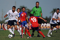 Tony Taylor (13) of the USA is defended by Jose Varela (19) of Costa Rica as referee Jason Krnac watches. The US U-20 Men's National Team defeated the U-20 Men's National Team of Costa Rica 2-1 in an international friendly during day four of the US Soccer Development Academy  Spring Showcase in Sarasota, FL, on May 25, 2009.