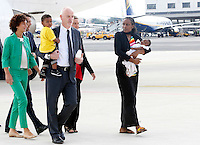 La sudanese Meriam Yahia Ibrahim Isha sbarca con la figlia Maya in braccio ed il figlio Martin in braccio al Viceministro degli Esteri Lapo Pistelli, a sinistra, dopo essere atterrata da Khartoum all'aeroporto militare di Ciampino, Roma, 24 luglio 2014. La giovane cristiana condannata a morte all'ottavo mese di gravidanza in Sudan, per apostasia e poi liberata, e' arrivata in Italia con i figli ed il marito, con un volo della presidenza del Consiglio, accompagnata da Pistelli ed accolta dal Presidente del Consiglio Matteo Renzi, secondo da destra, sua moglie Agnese Landini, sinistra, e dal Ministro degli Esteri Federica Mogherini, seconda da destra.<br /> Meriam Yahia Ibrahim Isha disembarks with her daughter Maya in her arms and her son Martin in the arms of Italian deputy Foreign Minister Lapo Pistelli, left, after landing from Khartoum at Ciampino's military airport, on the outskirts of Rome, 24 July 2014. The Sudanese christian woman who was sentenced to death in Sudan for apostasy, has arrived in Italy with her children and her husband by an Italian government's aircraft, accompanied by Pistelli and welcomed by Premier Matteo Renzi, second from left, his wife Agnese Landini, left, and Foreign Minister Federica Mogherini, second from right.<br /> UPDATE IMAGES PRESS/Riccardo De Luca