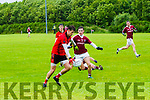 Glenbeigh/Glencar's Tommy Cahill has a go a Dromids Shane O'Connor closes in.