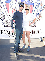 LAS VEGAS, NV - December 8:  Cris Angel and Pam Anderson pictured at Jesus ?Half Animal? Villa Guinness World Record attempt running 310 miles on spring-loaded stilts for ?The Longest Journey? between Las Vegas and Los Angeles from December 8 thru 18 starting on December 8, 2012 in Las Vegas, Nevada.  Credit: Kabik/ Starlitepics/MediaPunch Inc. /NortePhoto