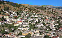 Houses in Gjirokastra, Southern Albania, in the historical region of Epirus, with most Ottoman houses dating from the 17th and 18th centuries. Typical houses consist of a tall stone block structure up to 5 storeys, with external and internal staircases surrounding the house. Gjirokastra was settled by the Greek Chaonians, the Romans and Byzantines before becoming an Ottoman city in 1417. Its old town was listed as a UNESCO World Heritage Site in 2005. Picture by Manuel Cohen