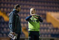 Wycombe Wanderers Assistant Manager Richard Dobson chats to Paul Hayes of Wycombe Wanderers before the Sky Bet League 2 match between Colchester United and Wycombe Wanderers at the Weston Homes Community Stadium, Colchester, England on 21 February 2017. Photo by Andy Rowland / PRiME Media Images.