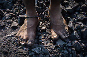 A miners feet seen in Goladi coal depot in Jharia, outside of Dhanbad in Jharkhand, India.  Photo: Sanjit Das/Panos