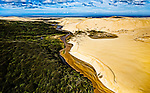 A meandering stream of gold between forest and sand is the road travelers take to access the northern end of Ninety Mile beach in the Far North..This New Zealand Fine Art Landscape Print, available in four sizes on either archival Hahnemuhle Fine Art Pearl paper or canvas, is printed using Epson K3 Ultrachrome inks and comes with a lifetime guarantee against fading..All prints are signed and numbered on the lower margin and come with my 100% money back guarantee on the purchase price, should you not be  completely happy with the quality of the delivered print or canvas.
