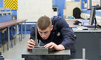 Marking out a job using a Vernier height gauge and surface plate.  Apprentice engineering students at Kingston College..