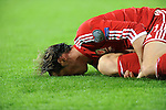UEFA European Championship at Cardiff City Stadium - Wales v Cyprus : <br /> Gareth Bale of Wales rolls on the ground with pain after a hard tackle by Charis Kyriakou of Cyprus late in the second half.