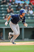 Left fielder Max White (4) of the Asheville Tourists bats in a game against the Greenville Drive on Thursday, August 13, 2015, at Fluor Field at the West End in Greenville, South Carolina. Asheville won, 8-1. (Tom Priddy/Four Seam Images)