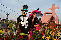 "A couple dressed as skeletons visiting Mixquic Cemetery during Day of the Dead celebrations. Mexicans visiting their dead relatives, lighting candles, lighting incense and decorating their graves for the Day of the Dead festival in San Andre de Mixquic shot as part of the Sony RX100 III ""Celebrate The Streets"" series."