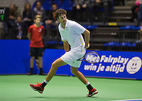 Rotterdam, Netherlands, December 20, 2015,  Topsport Centrum, Lotto NK Tennis, Final mens single Robin Haase (NED) returns the ball between his legs<br /> Photo: Tennisimages/Henk Koster
