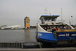 Ferry boat going over the Ij River to the Film Museum, Amsterdam, Netherlands.