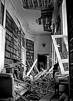 The badly damaged library following the Provisional IRA explosion at the home of the Earl of Caledon, Caledon, Co Tyrone, N Ireland, 10th November 1972. The Earl of Caledon is a member of the UDR, Ulster Defence Regiment. 197211100737b.<br /> <br /> Copyright Image from Victor Patterson, 54 Dorchester Park, Belfast, UK, BT9 6RJ<br /> <br /> t1: +44 28 9066 1296 (from Rep of Ireland 048 9066 1296)<br /> t2: +44 28 9002 2446 (from Rep of Ireland 048 9002 2446)<br /> m: +44 7802 353836<br /> <br /> e1: victorpatterson@me.com<br /> e2: victorpatterson@gmail.com<br /> <br /> The use of my copyright images is subject to my Terms & Conditions.<br /> <br /> It is IMPORTANT that you familiarise yourself with them. They are available on my website at www.victorpatterson.com.<br /> <br /> None of my copyright images may be used on a website unless they are visibly watermarked, i.e. © Victor Patterson within the body of the visible image. Metadata denoting my copyright must NOT be deleted. <br /> <br /> Web use is extra at currently recommended NUJ rates.