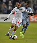 Rodrigo Salinas of Toluca (left) and Gerso Fernandes of Sporting KC vie for the ball during their CONCACAF Champions League game on February 21, 2019 at Children's Mercy Park in Kansas City, KS.<br /> Tim VIZER/Agence France-Presse