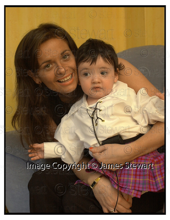 29th March 2001    Copyright Pic : James Stewart .Ref :                           .File Name : stewart05-sharon mcallister.SHARON MCALLISTER WITH HER 11 MONTH OLD SON, REECE, WHO IS A DIRECTOR OF HER DESIGN BUSINESS.....(see copy from George Mair / Tim Bugler)......James Stewart Photo Agency, Stewart House, Stewart Road, Falkirk. FK2 7AS      Vat Reg No. 607 6932 25.Office : +44 (0) 1324 630007     Mobile : 07721 416997.Fax     : +44 (0) 1324 630007.E-mail : jim@jspa.co.uk.If you require further information then contact Jim Stewart on any of the numbers above.........