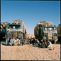 Bahai, Chad, Dec.11 2004..More than 2500 km from Benghazi and the Mediterranean sea, and already 800 km inside Chad, the convoy finaly reaches the first police post in Bahai, it will take about 3 days to clear the Kafka-esque Chadian administrative procedure...Some of the convoy's drivers.