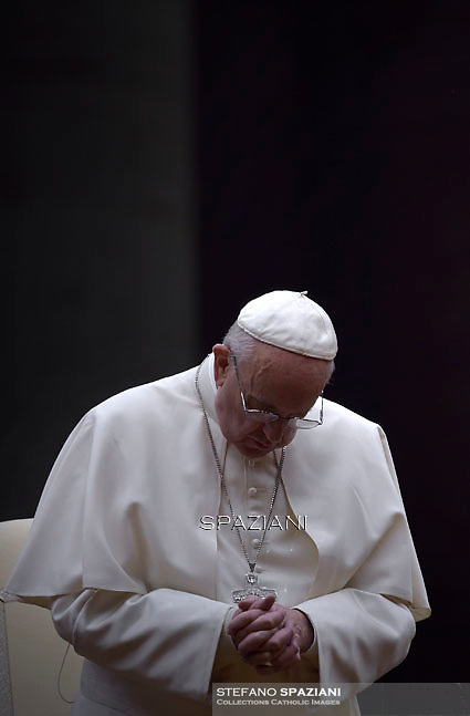 Pope Francis attends a vigil prayer on the eve of the XIV General Assembly of the Synod of Bishops at St Peter's basilica on October 3, 2015 at the Vatican.