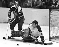 Seals Mike Laughton and Minnesota North Star goalie Gump Worsley...(1970 photo/Ron Riesterer)