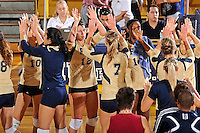 11 September 2011:  FIU's team (pictured, Sabrina Gonzalez (12), Una Trkulja (7), Renele Forde (14)) high-fives after winning the match.  The FIU Golden Panthers defeated the Florida A&M University Rattlers, 3-0 (25-10, 25-23, 26-24), at U.S Century Bank Arena in Miami, Florida.