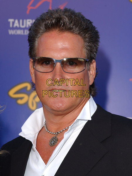 BILLY LUCAS.The 4th Annual Taurus World Stunt Awards held at The Paramount Picture Studios in Los Angeles California .May 16,2004.headshot, portrait, sunglasses, shades, necklace, pendant.www.capitalpictures.com.sales@capitalpictures.com.©Capital Pictures