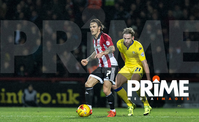 Goal scorer Sam Saunders of Brentford holds off Charlie Taylor  of Leeds United during the Sky Bet Championship match between Brentford and Leeds United at Griffin Park, London, England on 26 January 2016. Photo by Andy Rowland / PRiME Media Images.