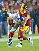 New York Giants tight end Rhett Ellison (85) is brought down by Washington Redskins outside linebacker Ryan Kerrigan (91) in second quarter action at FedEx Field in Landover, Maryland on Thursday, November 23, 2017.<br /> Credit: Ron Sachs / CNP<br /> (RESTRICTION: NO New York or New Jersey Newspapers or newspapers within a 75 mile radius of New York City)