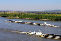 Two barges pass on the Mississippi River near Trail of Tears State Park in Jackson, Mo., on Oct. 17, 2010.