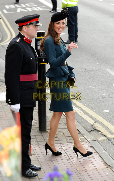 Catherine, Duchess of Cambridge (Kate Middleton).Accompanies the Royal family during their visit to Leicester, on first date of Queen Elizabeth II's Diamond Jubilee tour of the UK, England, UK,.March 8th 2012..full length green teal LK Bennett dress peplum jacket Episode shoes heels  princess black hat green side hand royalty belt .CAP/DH.©David Hitchens/Capital Pictures.