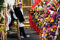 A man waits to participate on the 58th Silleteros' parade in the framework of the flowers' fair, this year the parade was declared intangible heritage of Colombia. Medellín, Colombia 09/08/2015