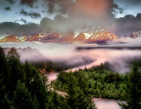 Snake River and Teton Mountains with storm clouds and morning light. Teton National Park, Wyoming.