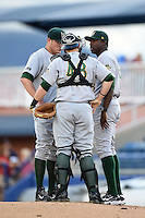 Lynchburg Hillcats pitching coach Derrick Lewis (43 - right) talks with catcher Joseph Odom (48) and pitcher Patrick Scoggin (28) during a game against the Salem Red Sox on April 25, 2014 at Lewisgale Field in Salem, Virginia.  Salem defeated Lynchburg 10-0.  (Mike Janes/Four Seam Images)