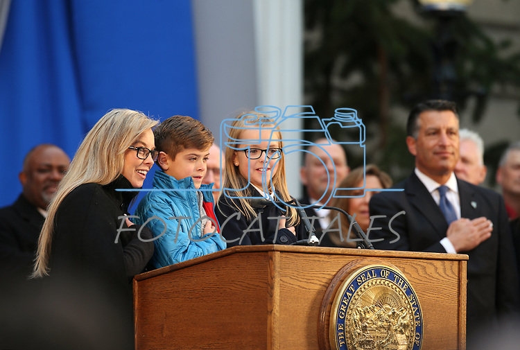 Reno Mayor Hillary Schieve helps Nevada fourth-graders Cooper Sandoval and Sydney Larsen lead the Pledge of Allegiance during the inauguration at the Capitol, in Carson City, Nev., on Monday, Jan. 7, 2019. <br /> Photo by Cathleen Allison/Nevada Momentum