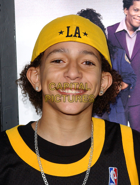 KHLEO THOMAS.At the MGM Pictures' World Premiere of Soul Plane, held at The Mann Village Theatre in Westwood, California,.May 17,2004.half length half-length yellow cap .*UK sales only*.www.capitalpictures.com.sales@capitalpictures.com.©Debbie Van Story/Capital Pictures
