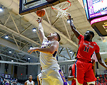 Stony Brook defeats UAlbany  69-60 in the America East Conference tournament quaterfinals at the  SEFCU Arena, Mar. 3, 2018.   Junior Saintel (#11) rises to defend aganist Greg Stire (#43).