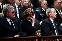 Former Florida Gov. Jeb Bush, Laura Bush and former President George W. Bush listen during a State Funeral for former President George H.W. Bush at the Washington National Cathedral, Wednesday, Dec. 5, 2018, in Washington. <br /> CAP/MPI/RS<br /> &copy;RS/MPI/Capital Pictures