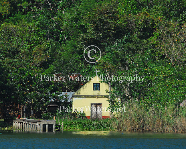 A small church sits along the banks of the Rio Dulce in Guatemala.